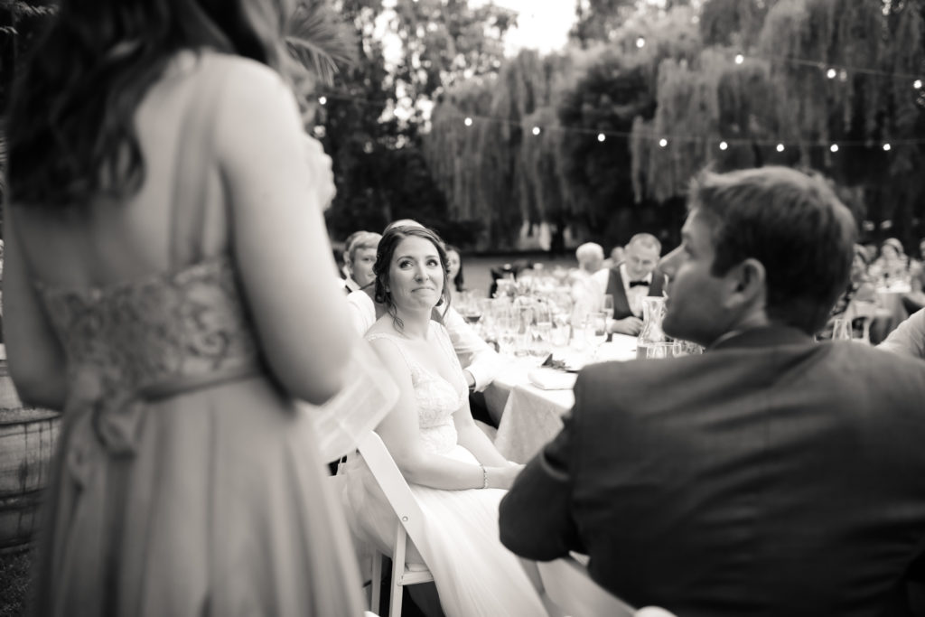 bride getting teary eyed during maid of honor's toast at Cline Cellars in Sonoma