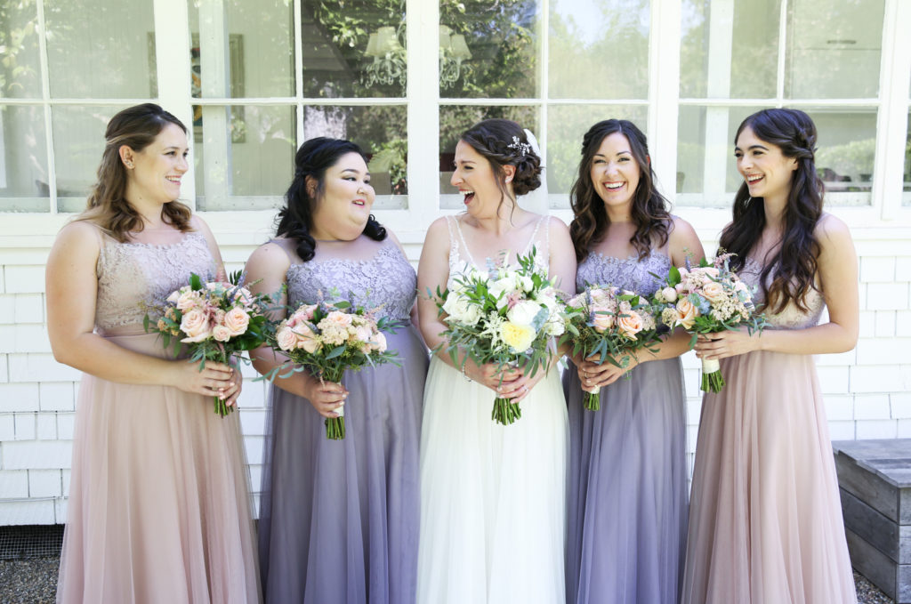 bride having a fun moment with bridesmaids before the wedding at Cline Cellars in Sonoma
