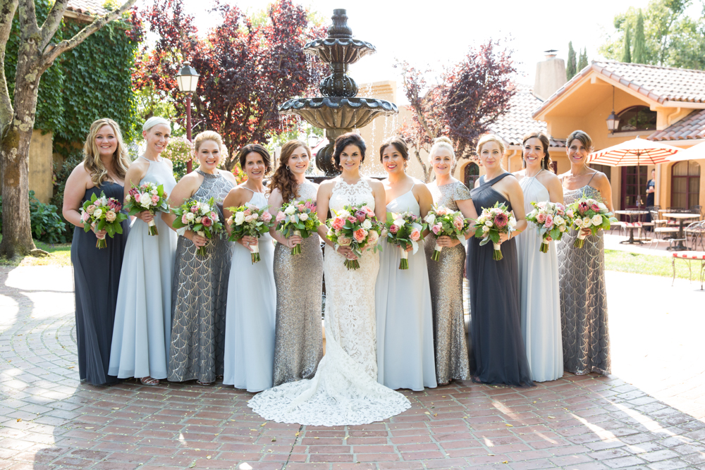 bride and bridesmaids by a fountain at Vintners Resort in Santa Rosa, CA