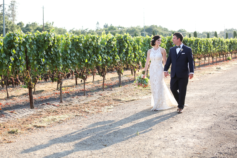 newlyweds by vineyards