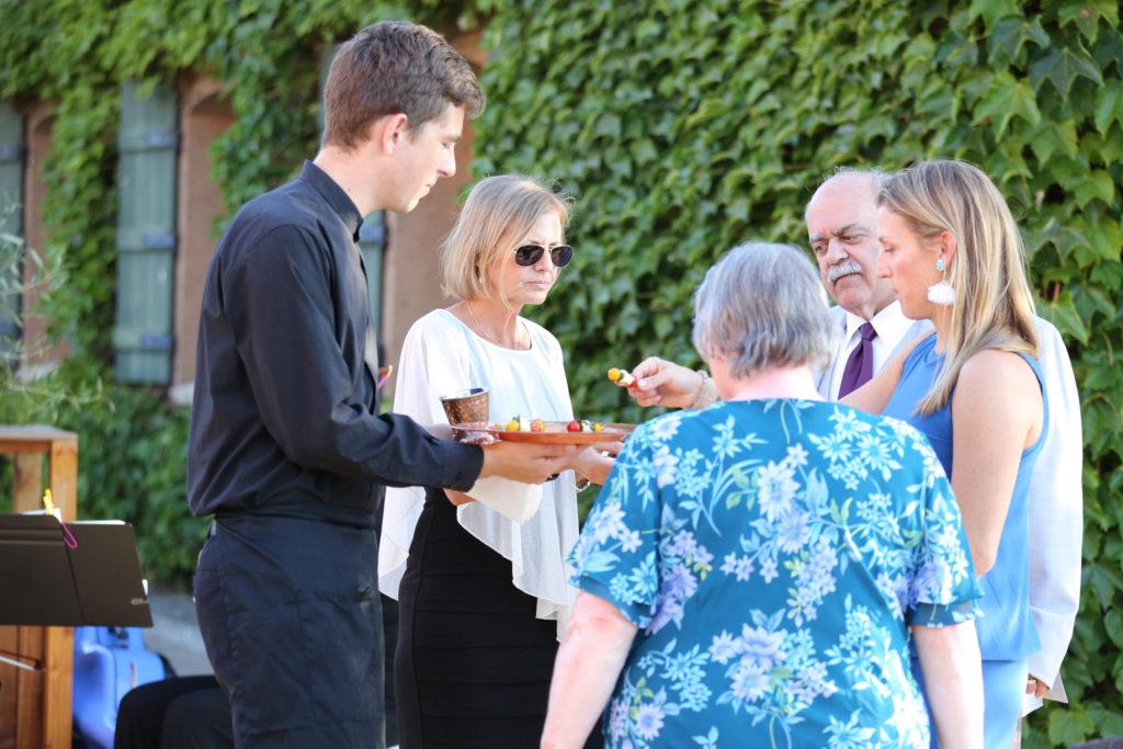 wedding guests enjoying horderves by Elaine Bell
