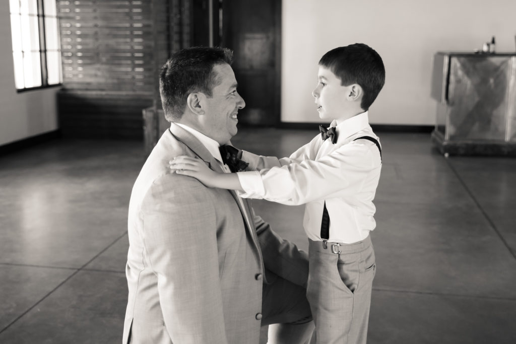 father son moment before wedding ceremony