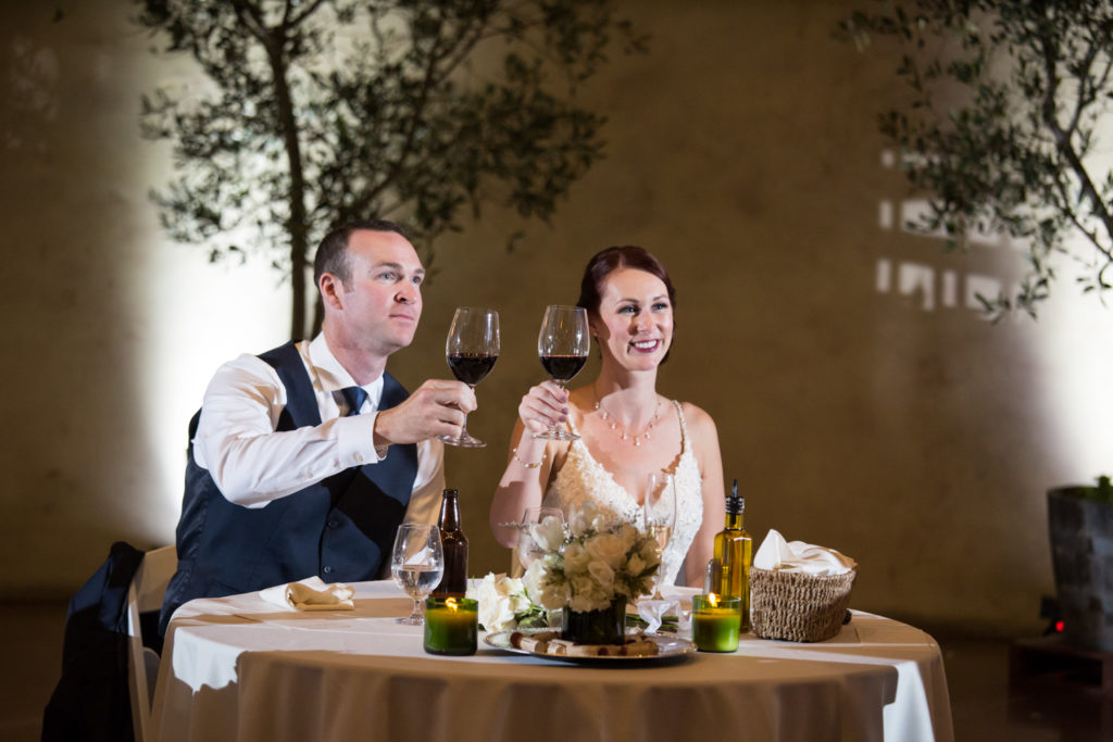 newlyweds toasting at wine cave