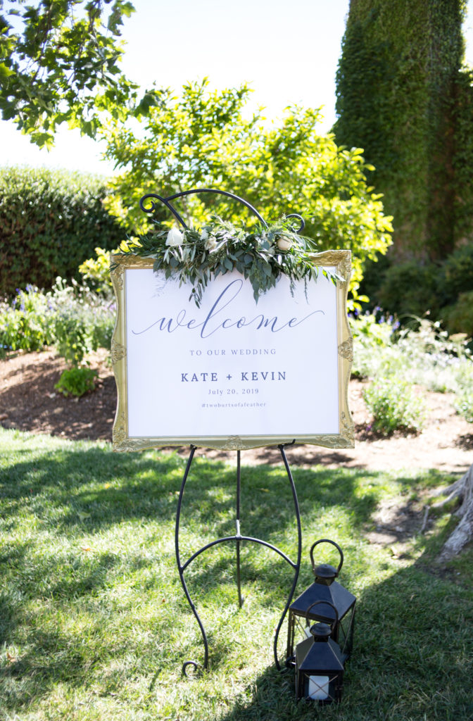 Wedding Sign in gold frame and white flowers