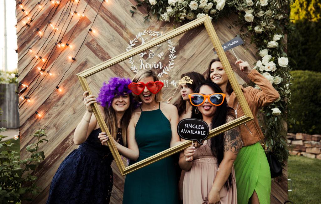 Wedding guests having fun at Photo booth