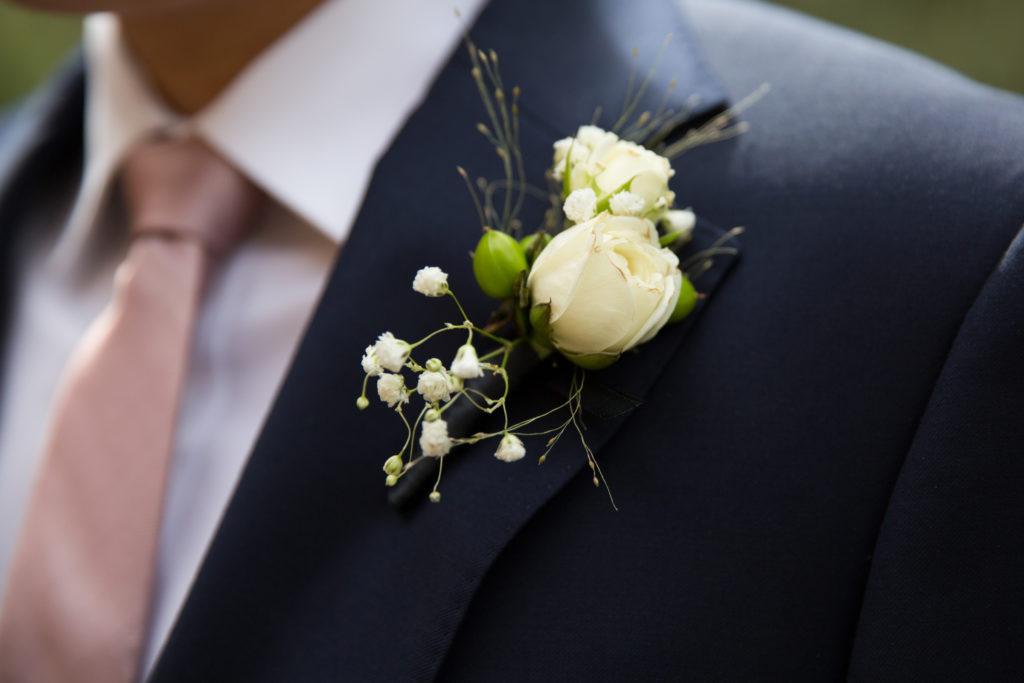 white groom's boutonnière